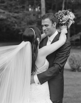 black-and-white-photo-of-bride-with-veil-and-groom