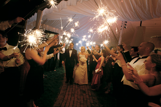 guests-hold-sparklers-to-form-an-arch