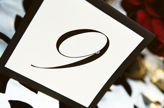 black-table-number-on-white-stationery-with-diamond