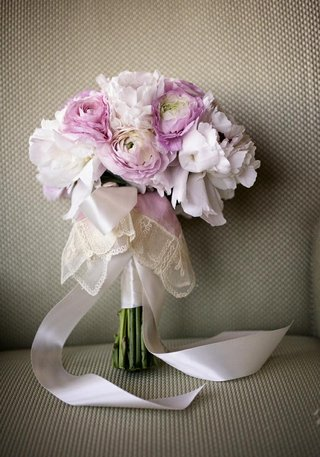pink-peony-and-ranunculus-flowers-tied-with-lace