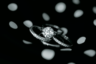black-and-white-engagement-ring-and-three-wedding-bands