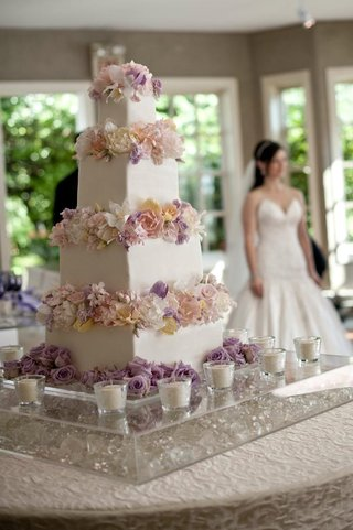 four-layer-white-wedding-cake-with-flower-decorations