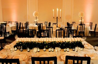 rectangular-table-topped-with-votives-and-roses