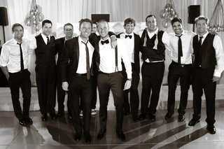 black-and-white-photo-of-groomsmen-at-reception