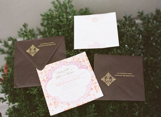 brown-and-gold-envelopes-with-orange-and-pink-wedding-invite