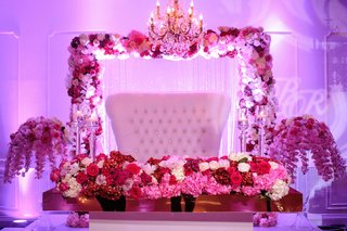purple-lighting-sweetheart-table-white-tufted-settee-pink-red-purple-flowers-orchids-roses