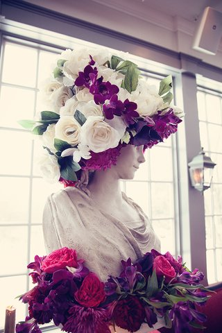 bust-topped-with-white-roses-and-fuchsia-orchids-and-surrounded-by