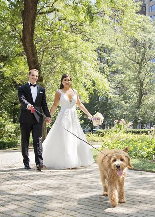 bride-in-hayley-paige-a-line-gown-with-sequin-details-groom-in-tuxedo-bride-and-groom-walking-dog