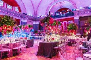 weylin-b-seymours-wedding-reception-with-pink-purple-and-greenery-decorations-with-uplighting