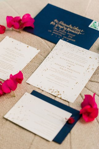 wedding-invitation-gold-and-white-splatter-confetti-theme-with-navy-blue-envelope-gold-calligraphy