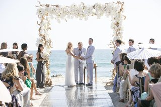 bride-and-groom-getting-married-with-ocean-backdrop