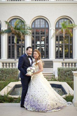 bride-in-purple-floral-romona-keveza-wedding-dress-groom-in-navy-tuxedo