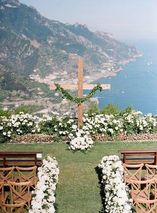wedding-ceremony-outdoor-italy-amalfi-coast-destination-white-flowers-tan-vineyard-chairs-pews-bench