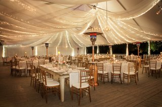 rustic-venue-filled-with-wood-tables-and-chairs