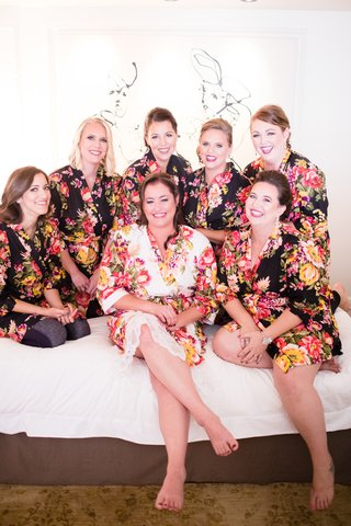 bridesmaids-in-black-floral-bridesmaid-robess-bride-in-white-floral-robe