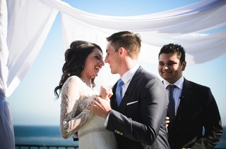 couple-enjoys-first-dance-at-oceanside-reception