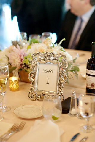 wedding-reception-table-with-table-number-in-ornate-silver-frame