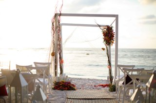 white-arbor-beach-mexico-colorful-flowers-chuppah-altar-punta-mita-wedding-styled-shoot-sand-ocean