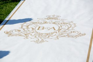 white-runner-with-gold-trim-and-monogram