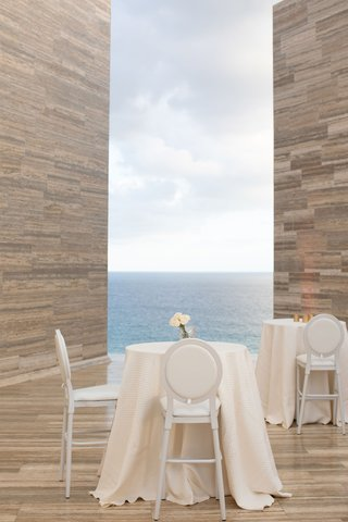 wedding-cocktail-hour-at-modern-hotel-resort-in-cabo-mexico-tall-white-linen-table-counter-stools