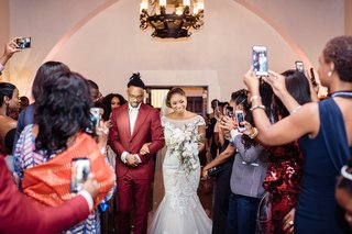 bride-walked-down-the-aisle-by-her-brother-guests-take-pictures-of-processional