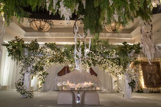 wedding-reception-with-modern-sweetheart-table-banquette-seating-dream-catcher-and-white-flowers
