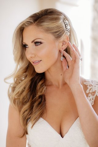 amy-crawford-pretty-makeup-curled-hair-side-part-headpiece-drop-earrings-v-neck-gown
