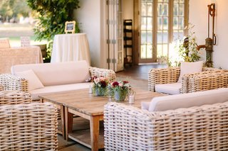wicker-lounge-furniture-wooden-coffee-table-faux-wedding-party-styled-shoot-rustic-event-florals