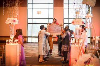 indian-bride-carried-into-ceremony-with-doli