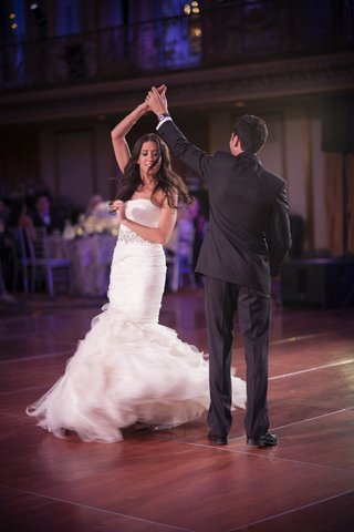 bride-in-vera-wang-wedding-dress-spins-during-first-dance-with-groom-in-chicago