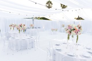 tented-reception-white-space-pink-cream-and-green-centerpieces-ghost-chairs