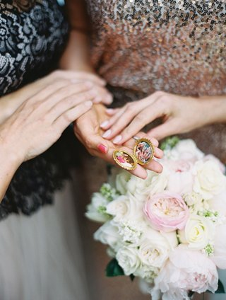 bride-and-family-holding-bouquet-and-gold-locket-with-photos-in-it-of-family