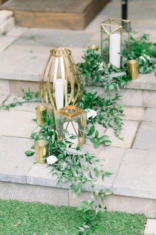 italian-ruscus-at-base-of-unique-gold-lanterns