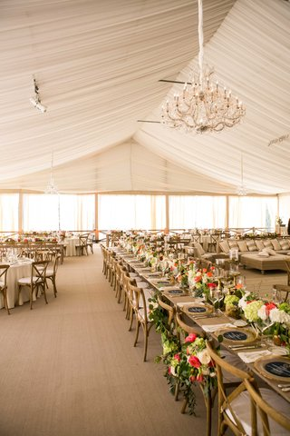 tent-wedding-at-villa-bianco-in-texas-with-chandelier-rustic-tables-and-green-centerpieces