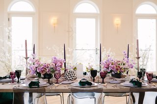 edgy-alternative-wedding-inspiration-lavender-stock-tapered-candles-colorful-goblets