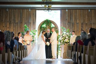 new-york-jets-brian-winters-wedding-groom-in-tan-suit-bride-in-pronovias-wedding-dress-barn