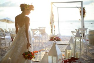 bride-walking-down-aisle-beach-colorful-motif-white-accents-flower-crown-arch-chuppah-flowers-ocean