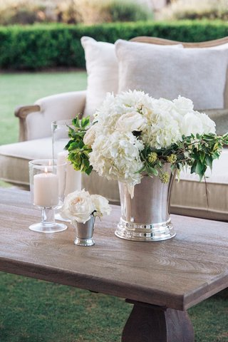 white-rose-and-hydrangea-centerpiece-on-wood-coffee-table
