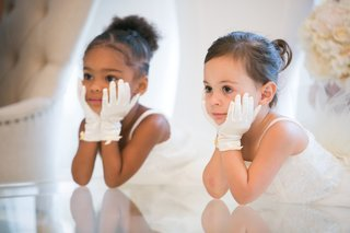 adorable-flower-girls-with-white-gloves-and-hands-on-faces