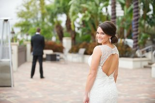 bride-wearing-diamond-earrings-and-lace-wedding-dress