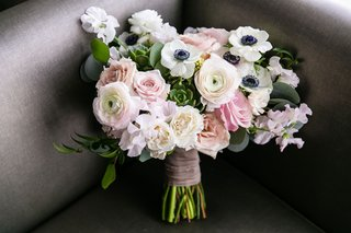 wedding-bouquet-anemone-ranunculus-rose-ribbon-around-green-stems-succulents