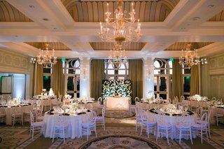 casa-del-mar-wedding-reception-ballroom-chandelier-sweetheart-table-greenery-white-centerpieces