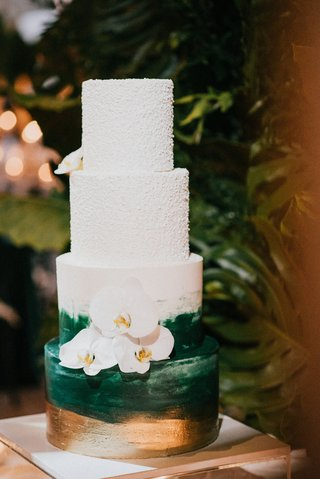 wedding-cake-with-four-layers-gold-and-green-brush-stroke-paint-design-textured-top-layers-orchid