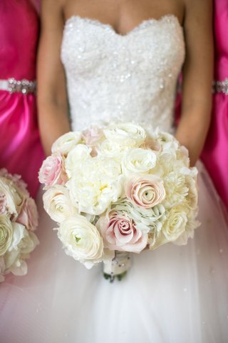 bride-in-strapless-reem-acra-wedding-dress-white-ivory-ranunculus-pink-roses-flowers