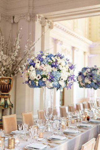 tall-weddign-reception-centerpiece-with-blue-purple-pink-and-white-flowers