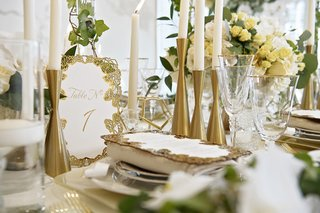 wedding-table-numbers-with-gold-laser-cut-border-in-rose-design