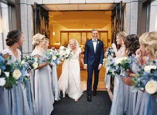 bridesmaids-in-joanna-august-wrap-dresses-welcome-new-husband-and-wife-outside-of-the-mormon-church