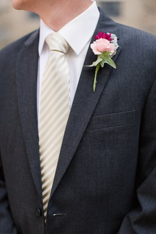 groom-in-charcoal-suit-and-striped-tie-with-pink-flower-on-lapel