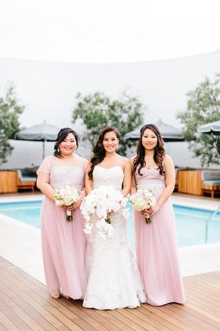 bride-with-bridesmaids-in-light-pink-long-dresses-different-necklines-short-sleeve-sheer-sleeveless