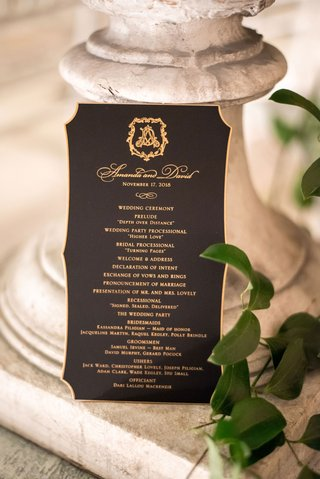 wedding ceremony program black stationery gold foil monogram and border